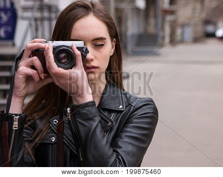 Female photographer. Old school electronics. Beautiful art person, photo shoot background, retro camera, creative hobby for young people