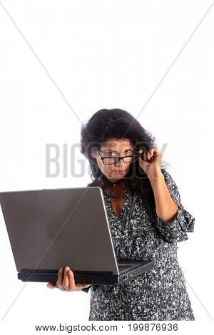 Latina business woman with laptop. Hispanic business woman, hot teacher, or typical housewife or mother, uses her laptop computer. isolated on white. room for text.