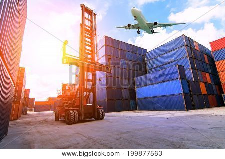 Forklift handling container box loading to freight trainer