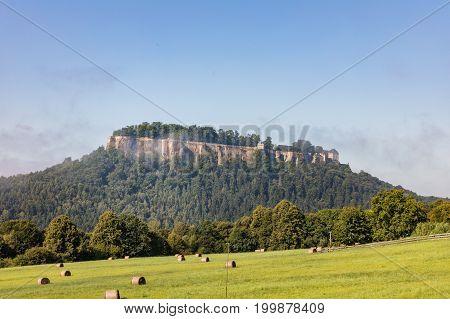 Germany. Saxon Switzerland. Fortress of Koenigstein in summer day. Fortress wall of German castle Konigstein