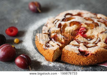 Rustic Plum Cake Garnished With Gooseberry And Mint