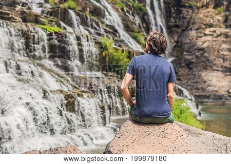 Man Hiker, Tourist On The Background Of Amazing Pongour Waterfall Is Famous And Most Beautiful Of Fa