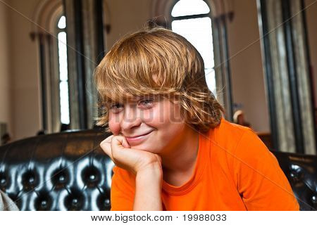 Boy Takes A Rest At A Sofa