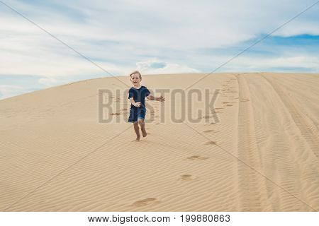 Boy In The Desert. Traveling With Children Concept