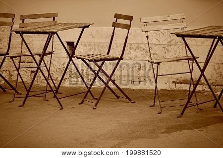 empty tables and chairs for an interior of summer cafe on the street or for a summer garden
