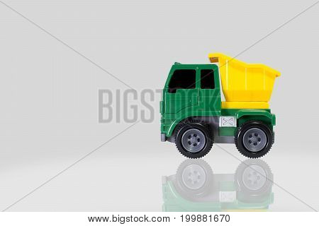 Truck toy mini truck scale model made of plastic with multicolor isolated on grey background.