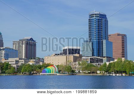 Lake Eola, High-rise buildings, skyline, Walt Disney Amphitheatre and fountain at Downtown Orlando, Florida, United States, April 27, 2017.
