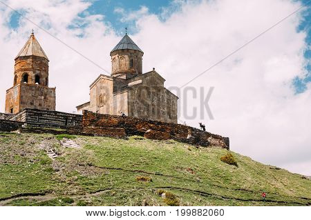 Gergeti Trinity Church Or Tsminda Sameba - Holy Trinity Church Near Village Of Gergeti In Georgia. Church Is Situated At An Elevation Of 2170 Meters, Under Mount Kazbegi. Spring Or Summer Season.