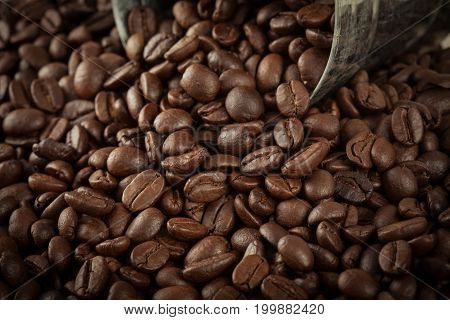 Close Up Pile Of Coffee Bean Pour Out Of The Small Silver Tank With Vintage Color Style.