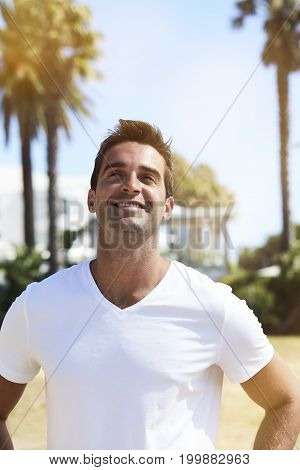 Young Happy guy in white t-shirt smiling