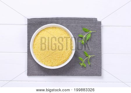 bowl of raw couscous on grey place mat