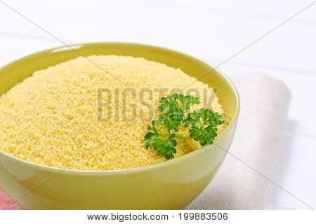 bowl of raw couscous - close up