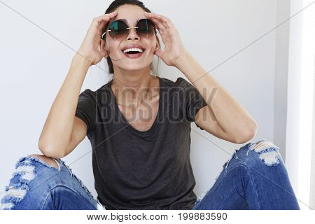 Young cute Laughing babe in shades portrait