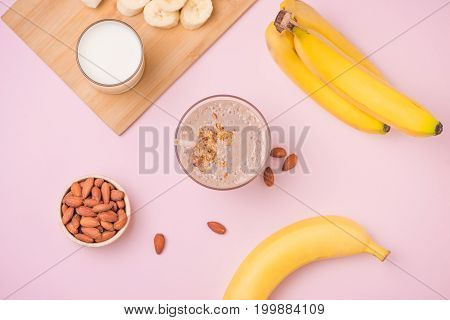Fresh Made Banana Smoothie In A Glass On Pink Background