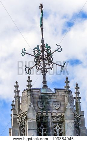 NEW HAVEN, CONNECTICUT-JUNE 24, 2017 Tower Windvane Yale University Sterling Memorial Library Statue New Haven Connecticut Fifth largest library in the United States
