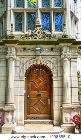 NEW HAVEN, CONNECTICUT-JUNE 24, 2017 Wooden Brown Door Multicolored Blue Window Berkeley College Yale University New Haven Connecticut.