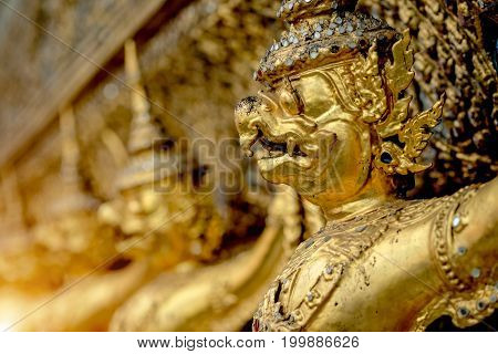 The golden garuda statues stand around main church and hand to lift the base of the golden church of thailand at wat phra kaew.