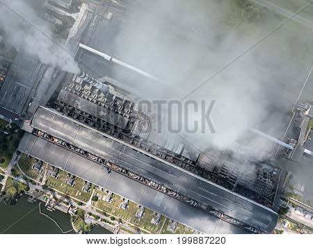 Working power station with steaming chimneys. It uses coal fuel. Top view panoramic photo. Horizontal.
