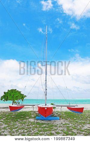 Boat on beach near sea