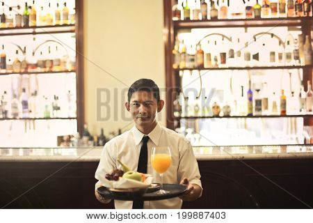 Waiter at the hotel