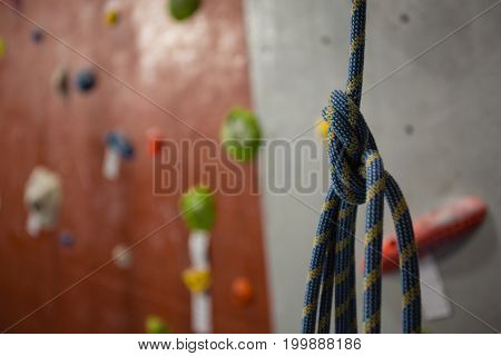 Close up of rope hanging against climbing wall at gym