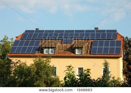 House with solar panels on the roof in germany poster