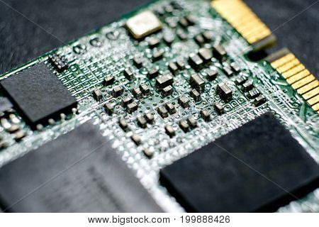 Close up image of electronic circuits in technology on micro hard drive mainboard computer background.