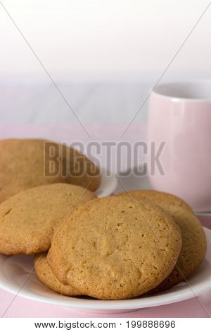 Honey Snaps on Plate with Cup on Pink Cloth Vertical with Copy Space