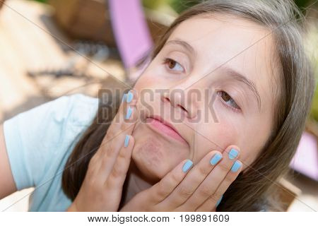 a portrait of pretty beautiful young girl making faces
