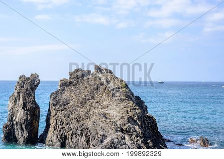 Daylight view to water splashing rock and blue sea. Monterosso al Mare, Italy, Cinque Terre