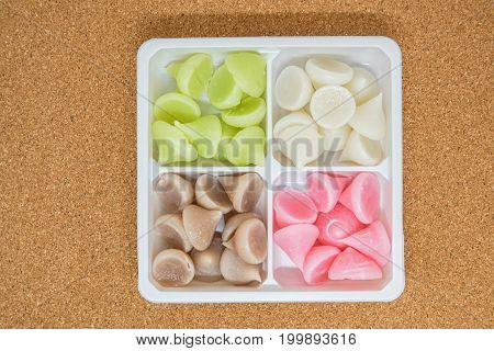 close up alua colorful sweet in plastic container