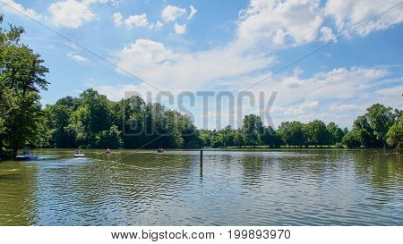 Tourists have fun with boats on a artifial lake in Germany