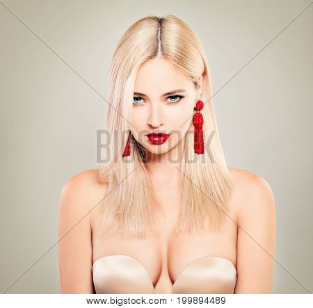 Sexy Model with Blonde Hair Red Lips and Golden Bra. Alluring Blondie Woman with Perfect Hairstyle and Makeup
