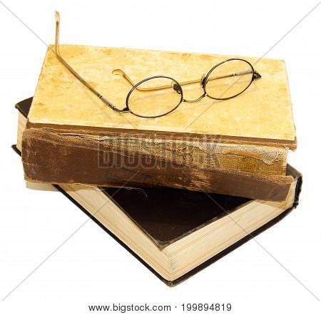 On An Old Book With A Torn Binding And A Broken Spine Are Glasses