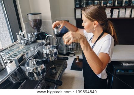 Portrait of Caucasian barista woman with two cups of fresh espresso cappuccino. Waitress serving holding hot drinks. Preparing coffee in restaurant shop cafe. Busy life of local small business.
