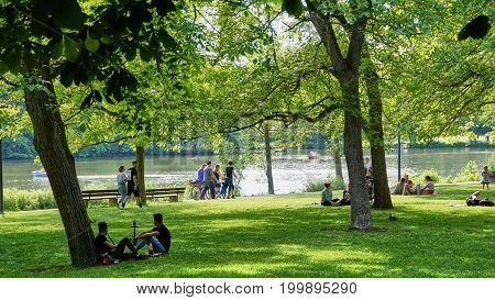 Ludwigsburg Germany - June 10th 2017: People having a Picnic in Castle park Monrepos during the annual fish festival.
