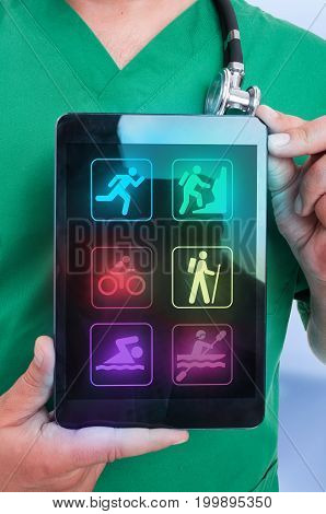 Closeup View Of Male Physiotherapist Holding Touchpad