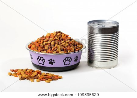 Colorful dry cat dog food in granules in cute bowl isolated on white background. Canned pet food. Variety of domestic animal meal.