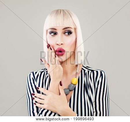 Fashion Portrait of Surprised Woman in Striped Cloth. Beautiful Girl Fashion Model with Makeup Bob Hairstyle and Manicure on Background with Copy Space
