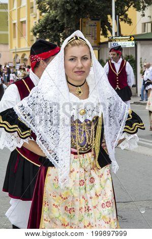 QUARTU S.E., ITALY - SEPTEMBER 15, 2013: Grape Festival in honor of Sant'Elena celebrations (folk group Santa Lucia of Settimo San Pietro) - Sardinia