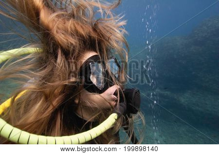 Scuba Diver Exploring The Bottom Underwater, Blue, Color Image