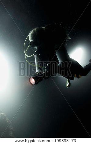 Scuba Diver Exploring The Bottom Underwater, Blue, Color Image