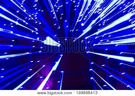 Speed of light - blue traces from points of light in space. abstract background