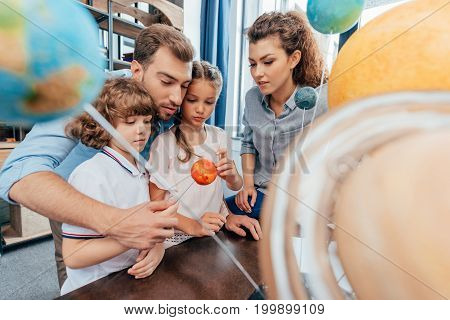 Family Making Solar System Model For School Project