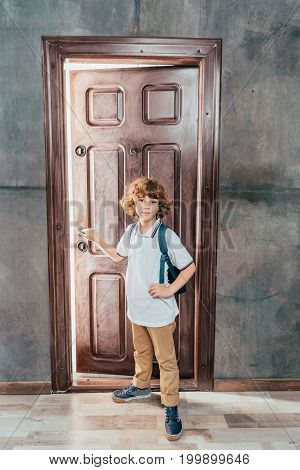 Cute Little Boy Going To School, Standing Next To Door