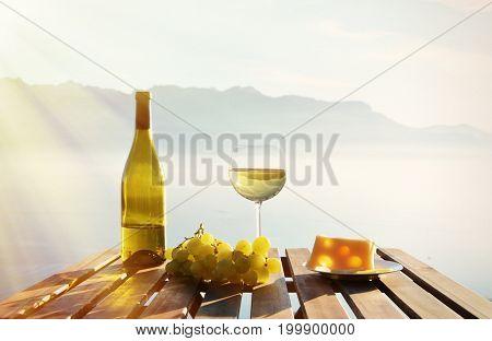 Wine, grapes and cheese. Lavaux region at Geneva lake, Switzerland