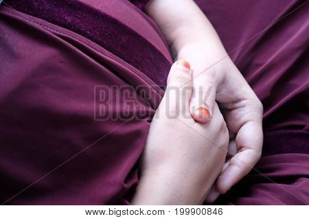 Young pregnant woman holds her hands on her swollen belly. Love concept
