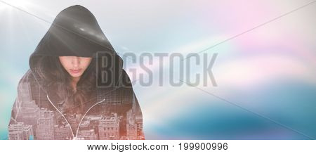 Female hacker in black hoodie against multi colored sunlight on sunny day