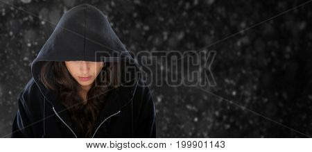 Female spy in hoodie against black background