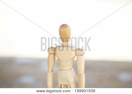 Wooden artist mannequin isolated on white background